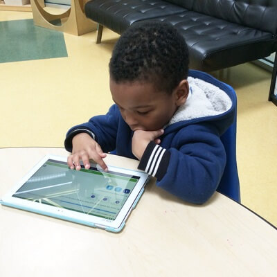 boy playing tablet